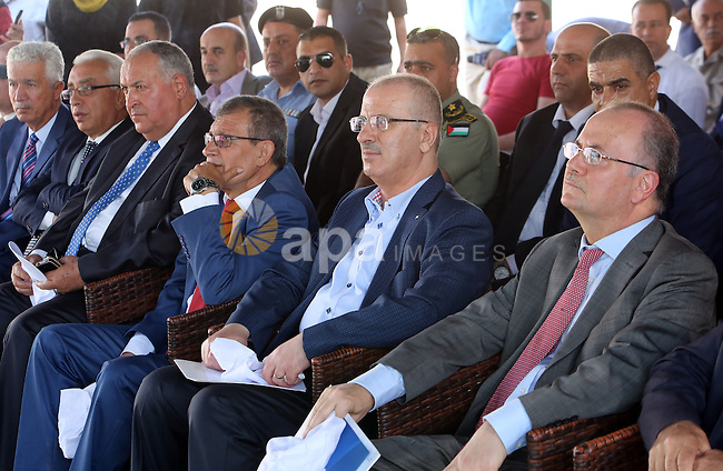 Palestinian Prime Minister, Rami Hamadallah, attends the Opening the Palestine Company for the production and marketing of fresh herbs,in Jeftlek village near Jordan Valley in the West Bank, on Oct 30, 2016. Photo by Prime Minister Office