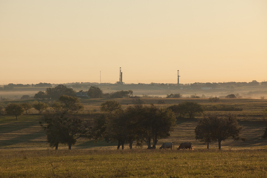 DEWITT COUNTY, TX - SEPTEMBER 25, 2013: Fracking activity - drilling in the Eagle Ford shale - can be seen on the horizon of south Texas ranch land.  CREDIT: Lance Rosenfield/Prime