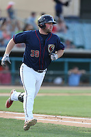 Chase McDonald #39 of the Lancaster JetHawks runs to first base against the Inland Empire 66ers during a playoff game at The Hanger on September 7, 2014 in Lancaster, California. Lancaster defeated Inland Empire, 5-2. (Larry Goren/Four Seam Images)