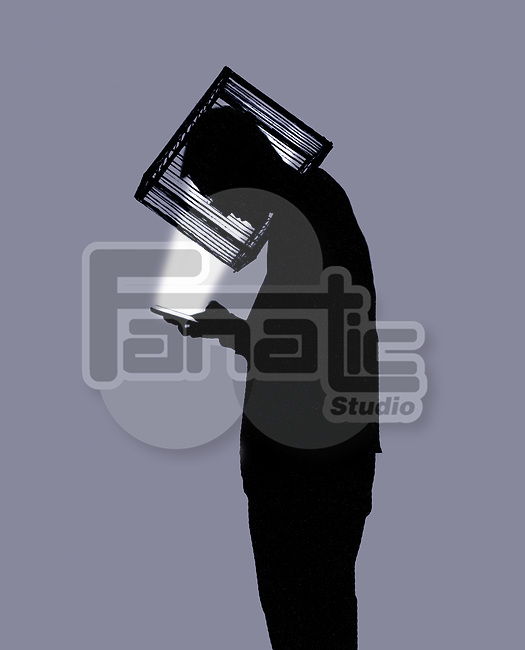 Concept image of a young man whose head is inside a cage on a smartphone depicting social media addiction