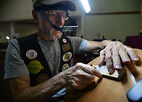 NWA Democrat-Gazette/ANDY SHUPE<br /> Warren Rauscher of Raymore, Mo., works Saturday, Sept. 7, on a chip carving on a wooden bookmark during the Woodcarvers of NWA Show at Frisco Station Mall in Rogers. The show continues 10 a.m. to 4 p.m. today.