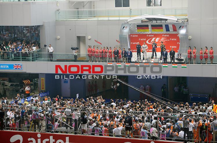 25.-27-10-2013, Jaypee-Circuit, Noida, IND, F1, Grosser Preis von Indien, Noida, im Bild Podium - Sebastian Vettel (GER), Red Bull Racing - Nico Rosberg (GER), Mercedes GP - Romain Grosjean (FRA) Lotus Renault F1 Team - <br /> Adrian Newey (GBR), Red Bull Racing (ex. McLaren), Technical Operations Director <br />  Foto &not;&copy; nph / Mathis