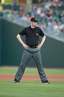Third base umpire Eric Gillam during the International League game between the Durham Bulls and the Charlotte Knights at BB&T BallPark on May 16, 2017 in Charlotte, North Carolina.  The Knights defeated the Bulls 5-3. (Brian Westerholt/Four Seam Images)