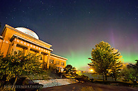 The Old Marquette County Courthouse in the Upper Peninsula of Michigan, where scenes of Anatomy of a Murder were filmed, shines brightly against a backdrop of aurora borealis northern lights - photo, picture, image of the Old Marquette County Courthouse with the aurora northern lights