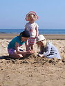 30/05/16 <br /> <br /> Autumn Wild, 10,  Austyn Wild, 6  and Aurelia Wild, 2 from Chesterfield playing on the beach. <br /> <br /> Bank Holiday Monday on Benllech beach in Anglesey<br /> <br /> All Rights Reserved: F Stop Press Ltd. +44(0)1335 418365   +44 (0)7765 242650 www.fstoppress.com