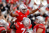 Ohio State Buckeyes running back J.K. Dobbins (2) celebrates a 52-yard touchdown run with offensive lineman Jamarco Jones (74) and offensive lineman Billy Price (54) during the third quarter of the NCAA football game at Ohio Stadium in Columbus on Sept. 16, 2017. [Adam Cairns / Dispatch]