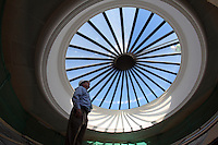Construction workers renovate the University of Virginia's Rotunda dome as part of roof replacement of the iconic building. Following removal of the glass, crews will install a temporary black membrane on the roof to protect the building's interior between the time the old skylight is removed and a new one is installed, around mid-March. While the Rotunda will remain open during the work, the Dome Room will have only limited access to visitors for about 12 weeks.<br /> The work is part of the first phase of the Rotunda renovations, which involves replacing the leaking roof and the oculus, as well as repairing the exterior brick walls, windows and ornamental sheet metal. Future phases include replacing the elevator, restoring the portico column capitals and improving the mechanical, electrical, plumbing, sprinkler and data systems.<br /> The total project, expected to take several years, will cost around $50 million. It is being funded through a mixture of state appropriations and private gifts. Photo/Andrew Shurtleff