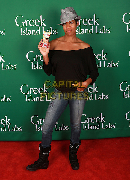 REGINA KING .Visits 2011 Golden Globes Gifitng Services suite On her Birthday held At Gifting Services Showroom, West Westwood, CA, USA, .15th January 2011..full length jeans black boots top grey gray hat fedora off the shoulders off the shoulder hand in pocket herringbone .CAP/ADM/KB.©Kevan Brooks/AdMedia/Capital Pictures.