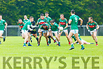Tomas Lynch St Kierans an Mike Breen Mid Kerry  contest the loose ball during their SFC clash in Brosna on Saturday