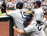 (L-R) Masahiro Tanaka, Francisco Cervelli, Ivan Nova (Yankees),<br /> APRIL 1, 2014 - MLB :<br /> Francisco Cervelli of the New York Yankees holds his teammate Masahiro Tanaka around his waist in the dugout during the baseball game against the Houston Astros at Minute Maid Park in Houston, Texas, United States. (Photo by AFLO)