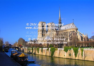 The Notre Dame Cathedral gracing the Seine River in Paris offers a scenic view of flying buttress architecture to the passers-by. (mms)