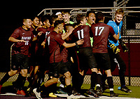 """Graham Thomas/Siloam Sunday<br /> Siloam Springs boys soccer players mob senior goalkeeper Wyatt Church after Church made two saves in the """"kicks from the mark"""" period in a 1-1 (3-1) victory over Russellville on Wednesday night at Panther Stadium."""