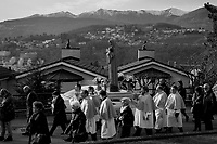 Switzerland. Canton Ticino. Pregassona. Religious procession. Four men carry a wooden sculpture of The Virgin Mary during the &quot;Festa patronale La Candelora&quot;. Mary was a 1st-century BC Galilean Jewish woman of Nazareth, and the mother of Jesus, according to the New Testament. Christians believe that she conceived her son while a virgin by the Holy Spirit. The Gospel of Luke begins its account of Mary's life with the Annunciation, when the angel Gabriel appeared to Mary and announced her divine selection to be the mother of Jesus. The Catholic Church holds distinctive Marian dogmas, namely her status as the Mother of God, her Immaculate Conception, her perpetual virginity, and her Assumption into heaven. Pregassona is quarter of the city of Lugano and a former municipality in the district of Lugano. 4.02.2018 &copy; 2018 Didier Ruef<br /> <br /> <br /> .
