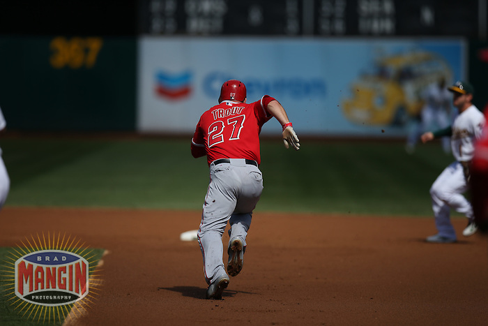 OAKLAND, CA - SEPTEMBER 24:  Mike Trout #27 of the Los Angeles Angels runs to second base against the Oakland Athletics during the game at O.co Coliseum on Wednesday, September 24, 2014 in Oakland, California. Photo by Brad Mangin