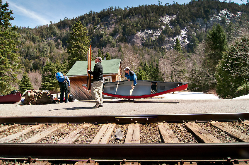 Unloading canoes and equipment from the Algoma Central Railway train in the Agawa Canyon of Ontario Canada.
