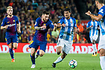 Lionel Andres Messi (l) of FC Barcelona fights for the ball with Chory Castro of Malaga CF during the La Liga 2017-18 match between FC Barcelona and Malaga CF at Camp Nou on 21 October 2017 in Barcelona, Spain. Photo by Vicens Gimenez / Power Sport Images