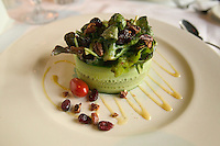 salad wrapped in cucumber and topped with nits and dried fruit