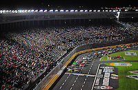 Oct. 17, 2009; Concord, NC, USA; NASCAR Sprint Cup Series driver Jimmie Johnson (48) races alongside Mark Martin (5) to start the NASCAR Banking 500 at Lowes Motor Speedway. Mandatory Credit: Mark J. Rebilas-