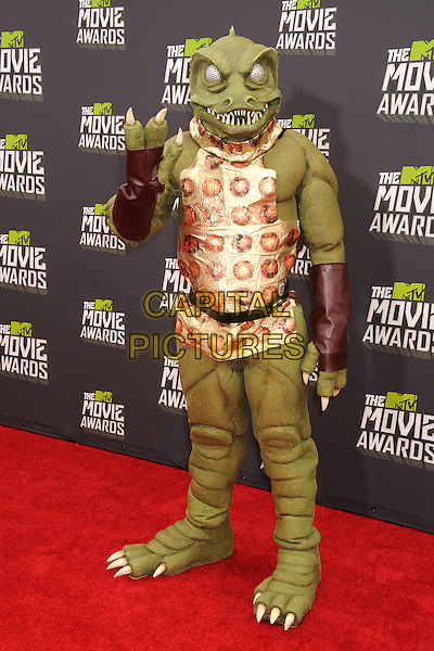 Gorn, Star Trek.2013 MTV Movie Awards - Arrivals held at Sony Pictures Studios, Culver City, California, USA..14th April 2013.full length hand arm lizard green costume .CAP/ADM/BP.©Byron Purvis/AdMedia/Capital Pictures