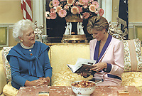 Mrs. Barbara Bush presents a copy of &quot;Millie's Book as Dictated to Barbara Bush&quot; to Her Royal Highness Princess Diana during this morning's tea in the private residence of the White House in Washington, DC on October 5, 1990. <br /> CAP/MPI/RS<br /> &copy;RS/MPI/Capital Pictures