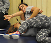 Yafreycy Taveras, Copiague High School junior, top, works on takedowns with classmate Kathy Rosada during wrestling practice at Copiague High School on Tuesday, Jan. 31, 2017.