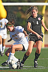 Manhattan Beach, CA 01/25/10 - Taylor Foland (Mira Costa #9) and Elizabeth Caparis (Palos Verdes #4) in action during the Bay League game between Mira Costa and Palos Verdes, Palos Verdes defeated Mira Costa 2-0.