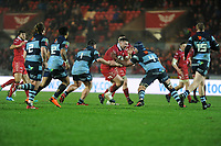 Rob Evans of Scarlets is tackled by George Earle of Cardiff Blues during the Guinness Pro14 match between the Scarlets and Cardiff Blues at Parc Y Scarlets, Llanelli, Wales, UK. Saturday 22 December 2018