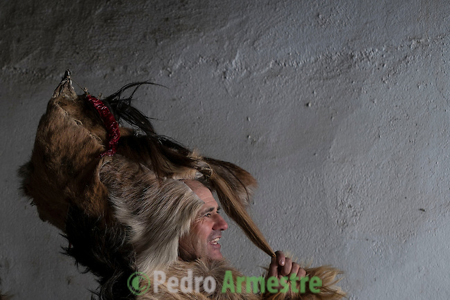 A man getting dressed for Carantoña before mass during the Carantoñas festival, in Acehúche, near Cáceres, on January 21, 2015 . In honor of its patron saint Sebastián. Believed to represent the martyrdom of St. Sebastian, who, after being shot with arrows, is left tied to a tree, where the beasts respected for his holiness and found the Christians still alive.  © Pedro ARMESTRE