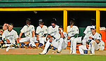 30 June 2012: Members of the Vermont Lake Monsters squint in the late day sun in the dugout during a game against the Lowell Spinners at Centennial Field in Burlington, Vermont. Mandatory Credit: Ed Wolfstein Photo