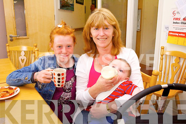 Isabelle Baily and Harry and Michelle Collins at the Rehab Centre Coffee morning on Thursday.