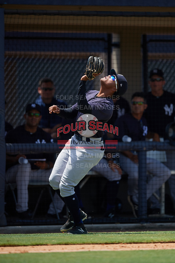 GCL Yankees East third baseman Starlin Paulino (6) settles under a pop up during a game against the GCL Yankees West on August 8, 2018 at Yankee Complex in Tampa, Florida.  GCL Yankees West defeated GCL Yankees East 8-4.  (Mike Janes/Four Seam Images)