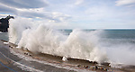 """The waves hit a retaining wall in the """"New Ride"""" of Donostia on February 9, 2014, Basque Country. (Ander Gillenea / Bostok Photo)"""