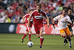 05 June 2009: Chicago's Brian McBride (20) is chased by Houston's Richard Mulrooney (right). The Houston Dynamo defeated the Chicago Fire 1-0 at Toyota Park in Bridgeview, Illinois in a regular season Major League Soccer game.