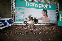 Christine 'Peanut' Vardaros (USA/Stevens) (hoping for a warm shower?) in front of the title sponsors bilboard <br /> <br /> Superprestige Gavere 2014