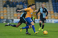 Mansfield Town's Nathan Thomas under pressure from Wycombe Wanderers Sido Jombati during the Sky Bet League 2 match between Mansfield Town and Wycombe Wanderers at the One Call Stadium, Mansfield, England on 31 October 2015. Photo by Garry Griffiths.