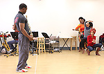 Michelle Williams & Adesola Osakalumi with ensemble cast rehearsing for the touring company of 'FELA!'  at the Pearl Studios in New York City on 1/23/2013