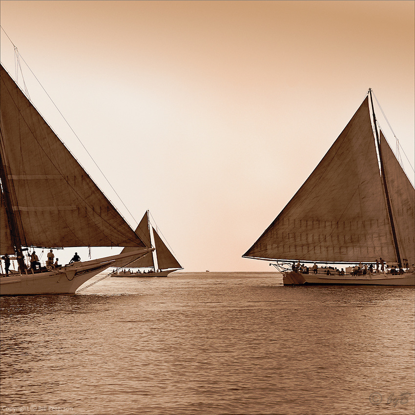 "Majestic vessels gliding across the Chesapeake Bay, ""Copper Sea"" is the most popular image in the Fine Art, Limited Edition ""Skipjack Sunday"" collection."