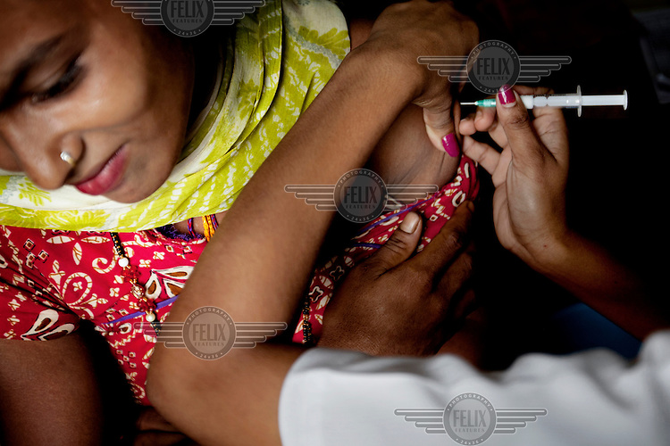 A woman recieves a contraceptive injection at a rural public health clinic.