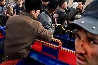 Men argue over a deal at a used vehicle market outside Kashgar, Xinjiang, China.