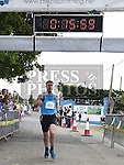 Martin Quinn crosses the line in third place in the Seamie Weldon 5K Run in Ardee. Photo:Colin Bell/pressphotos.ie