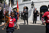 Children run back to their parents after blowing the horn with United States President Barack Obama before the Wounded Warrior Ride event at the White House, in Washington, DC, April 14, 2016.  The event helps raise awareness to the public about severely injured veterans and provides rehabilitation opportunities. <br /> Credit: Aude Guerrucci / Pool via CNP