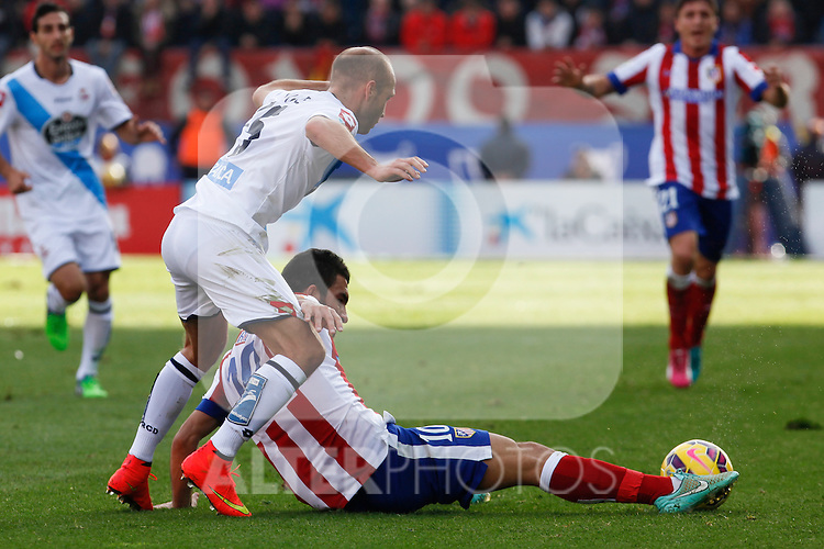 Atletico de Madrid´s Arda Turan (F) and Deportivo de la Coruña´s Laure during 2014-15 La Liga match between Atletico de Madrid and Deportivo de la Coruña at Vicente Calderon stadium in Madrid, Spain. November 30, 2014. (ALTERPHOTOS/Victor Blanco)