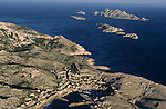 Coastal village of Goudes, with Jarre and Riou islands in the distance, Marseille, France.