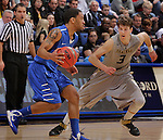 SIOUX FALLS, SD - MARCH 10:  Pierre Bland #2 of IPFW dribbles toward Travis Bader #3 of Oakland University during their quarterfinal game at the 2013 Summit League Basketball Championships at the Sioux Falls Arena Sunday. (Photo by Dick Carlson/Inertia)