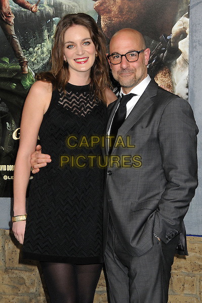 "Felicity Blunt, Stanley Tucci.""Jack The Giant Slayer"" Los Angeles Premiere held at Grauman's Chinese Theatre, Hollywood, California, USA..February 26th, 2013.half length black white shirt tie grey gray stubble facial hair sleeveless dress hand in pocket married husband wife glasses.CAP/ADM/BP.©Byron Purvis/AdMedia/Capital Pictures."