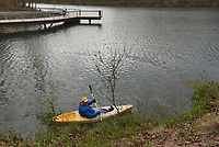 NWA Democrat-Gazette/FLIP PUTTHOFF <br /> CLEANUP BY KAYAK<br /> Rick McLeod (cq) with the Downtown Rogers Rotary Club looks for litter Saturday April 21 2018 along the Lake Atalanta shoreline during a cleanup day at Lake Atalanta Park near downtown Rogers. Individuals, families and organizations picked up litter throughout the park. The city of Rogers, Ozarks Water Watch, Benton County Extension Office and the Downtown Rogers Rotary Club organized the event.