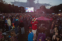 Wales fans celebrate their side's win at the Cardiff Fanzone during the Euro 2016 quarter final between Wales and Belgium , Cardiff, Wales on 1 July 2016. Photo by Mark  Hawkins/PRiME Media Images.