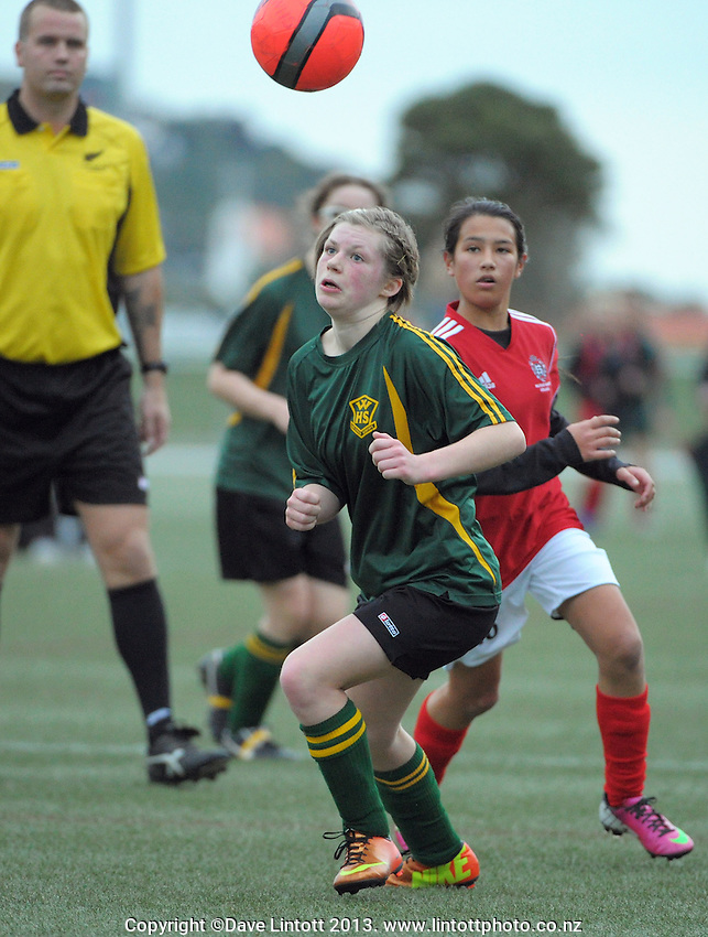 Action from Wellington girls college football bronze playoff final between Sacred Heart College and Wellington High School (green and gold) at Wakefield Artificial Turf,  Wellington, New Zealand on Wednesday, 21 August 2013. Photo: Dave Lintott / lintottphoto.co.nz