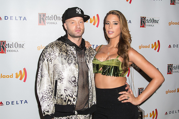 NEW YORK, NY - SEPTEMBER 12: Rapper and songwriter Cazwell, and model and performer Carmen Carrera attends the Annual GLAAD Manhattan Summer Benefit at Gansevoort Park Avenue in New York, NY. September 12, 2013. Photo by  Stulich/RTN/MediaPunch Inc.