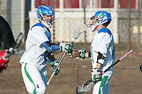Matt Heeter,'18, left, is congratulated by teammates after scoring on Anna Maria during the Salve Regina Men's Lacrosse game at Gaudet Field.